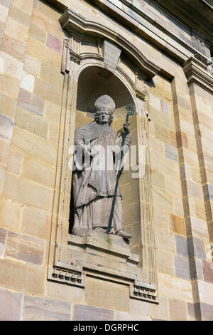 Statue of the monastery's founder Sturmius on the main portal of St. Salvator Cathedral of Fulda, Fulda Cathedral, - Stock Photo