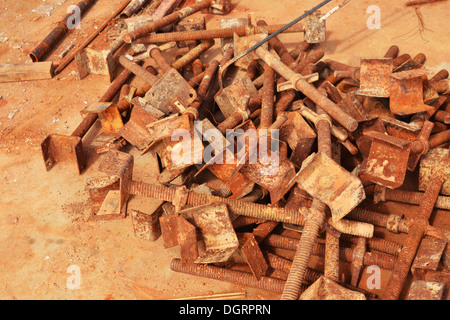 Rusty scrap metal on the ground. - Stock Photo