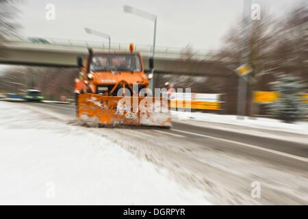 Snow plough in winter, Hesse - Stock Photo
