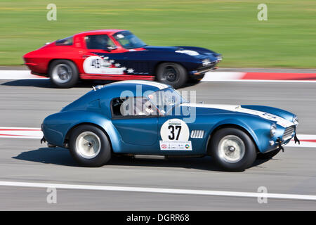 Race of post-war racing cars, Cobra and Corvette, at the Oldtimer Grand Prix 2010 on the Nurburgring race track - Stock Photo