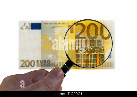 200 euro banknote under a magnifying glass, symbolic image, observation of the euro - Stock Photo