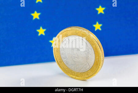 Old Greek 1 Euro coin in front of the flag of the European Union - Stock Photo
