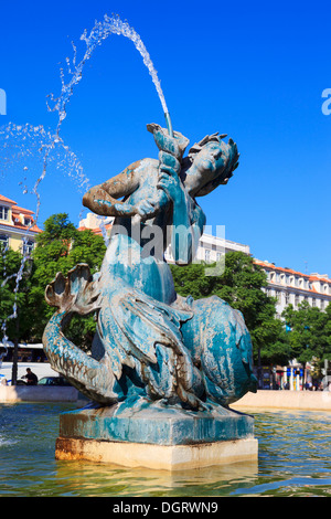 Baroque fountain on rossio square the liveliest placa in Lisbon - Stock Photo