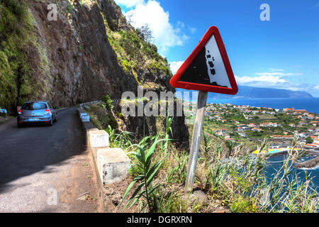 Warning sign, falling rocks, on road along the cliffs at Ponta Delgada, Vicente, Boaventura, Madeira, Portugal - Stock Photo