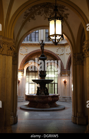 Fountain in Freyung Passage at Ferstel Palais, Vienna, Austria, Europe - Stock Photo