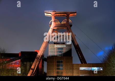 Winding tower shaft 12 in the evening, colliery Zeche Zollverein, UNESCO World Cultural Heritage, Essen-Katernberg, - Stock Photo