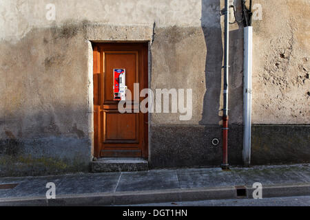 Condom vending machine on the door of a house, historic town centre of Langres, department of Haute-Marne - Stock Photo