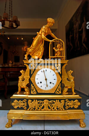 Gilded Biedermeier table clock in an antique shop, Bamberg, Upper Franconia, Bavaria - Stock Photo