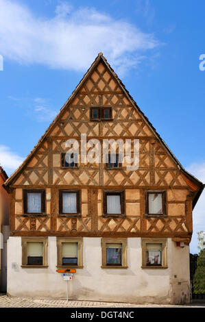 Gabled house with decorative timber frame from 17-18th Century, market square, Wipfeld, Lower Franconia, Bavaria - Stock Photo