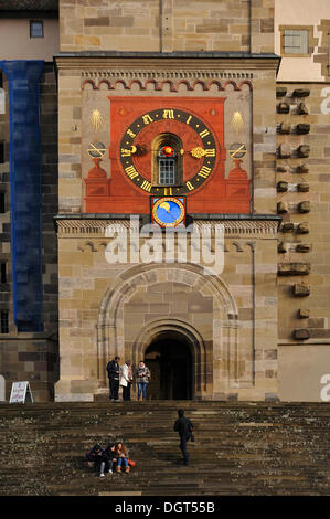 Main entrance with clock tower of the late Gothic Church of St. Michael, built in 1427, the grand staircase was - Stock Photo