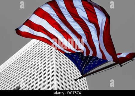U.S.-American flag flying in front of a skyscraper, New York City, New York, United States - Stock Photo
