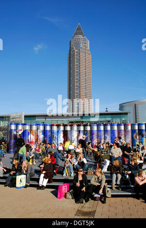 Frankfurt Book Fair, visitors in front of a promotion for Brockhaus encyclopedia in the Exhibition Grounds, behind - Stock Photo