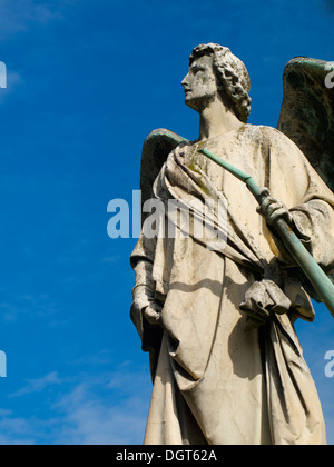 Angel statue looking up to sky. - Stock Photo