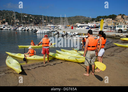Canoes, canoeing in the marina of Puerto Soller, Port de Soller, Mallorca, Majorca, Balearic Islands, Mediterranean - Stock Photo