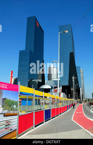 Construction site at the main railway station, Centraal Station, in the back the Delftse Poort office building at - Stock Photo
