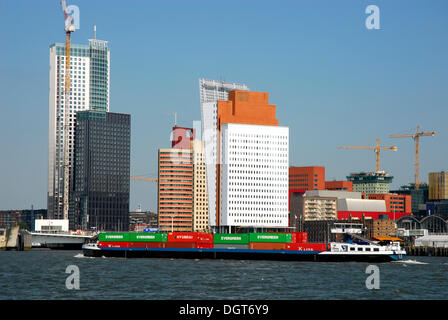 Container Transport on the Nieuwe Maas River, modern architecture at the Wilhelminapier at back, Rotterdam, Zuid - Stock Photo