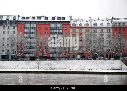 Houses on the snowy bank of the river, Sachsenhausen district, Frankfurt am Main, Hesse - Stock Photo