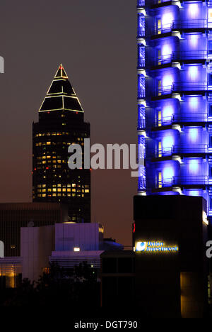 Messeturm fair tower by architect Helmut Jahn, Union Investment office building illuminated in blue, Bahnhofsviertel - Stock Photo