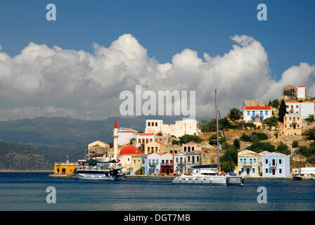 Houses and boats in the bay with the turkish coast at back, town Megisti on Kastelorizo island, Meis, Dodecanese - Stock Photo