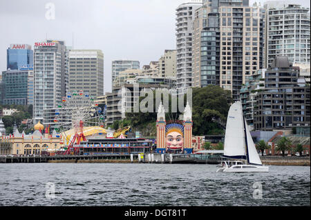 Sailing boat and Luna Park at Milsons Point, Sydney Harbour, North Sydney, New South Wales, NSW, Australia - Stock Photo