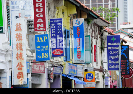 Signs at a facade, shops in the Indian district, Little India, city centre, Singapore, Asia - Stock Photo