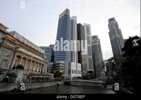 The Fullerton Hotel on Singapore River with Skyscrapers of the Financial District, Central Area, Central Business - Stock Photo