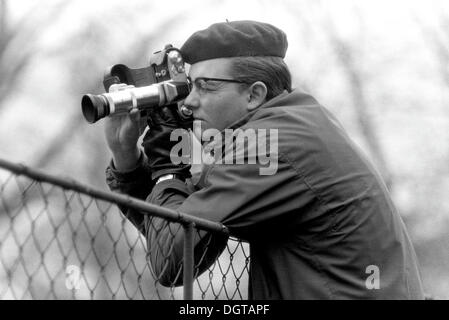 Young man taking pictures with a camera, about 1968, Leipzig, GDR, German Democratic Republic, Europe - Stock Photo