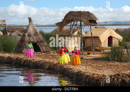 The floating village of Uros on Lake Titicaca in Peru - Stock Photo