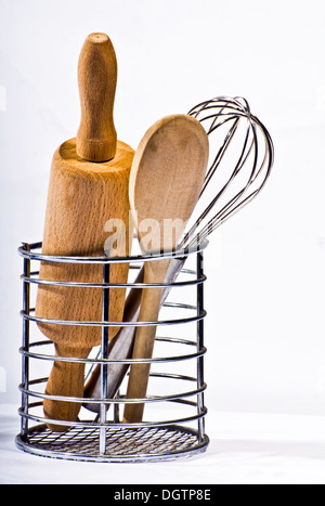 Kitchen utensils in a container on white background - Stock Photo