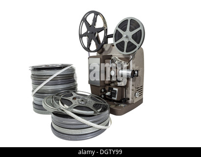 Vintage movie film reels and projector isolated with clipping path. - Stock Photo