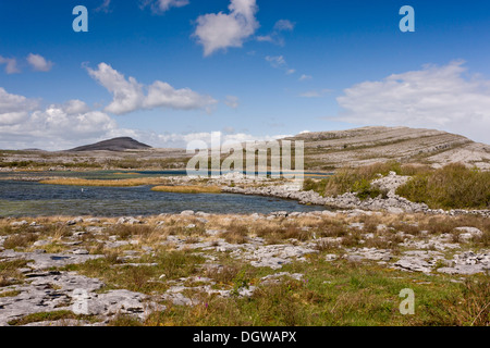 Carboniferous limestone scenery at Lough Geallain and Mullagh More, The Burren National Park, County Clare - Stock Photo