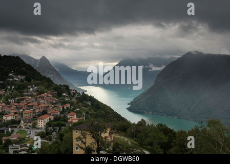 Bré VIllage viewed from Mount Bre, Gulf of Lugano and the Alps. Canton Ticino, Switzerland - Stock Photo
