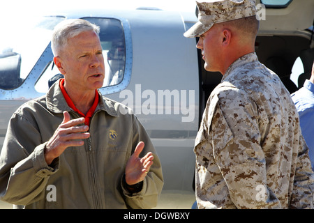 The commandant of the Marine Corps, Gen. James F. Amos, greets U. S. Marine Corps Sgt. Christopher A. Prior, right, field wireman, Marine Wing Communications Squadron 38 (MWCS-38), Marine Air Control Group 38, 3rd Marine Aircraft Wing, at Marine Corps Air