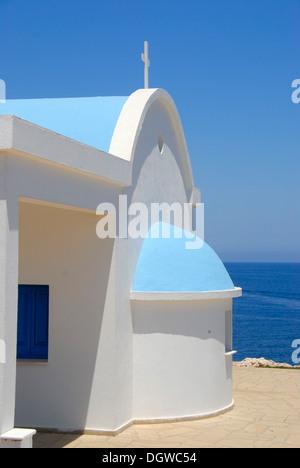 Greek Orthodox Christianity, Church of Ayioi Anargyri, Agioi Anargyroi, chapel, blue sea, Cape Greco, near Ayia - Stock Photo