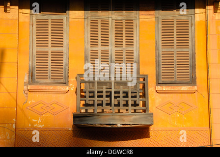 French colonial period façade with small balcony, windows with shutters, Thakhek, Khammuan province, Khammouane, - Stock Photo
