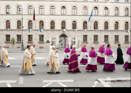 Catholic Corpus Christi procession, priests of various denominations taking part in parade, Ludwigstrasse street, - Stock Photo