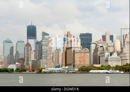 Metropolis, view of high-rise buildings and skyline, Financial District, Battery Park, One World Trade Center under - Stock Photo