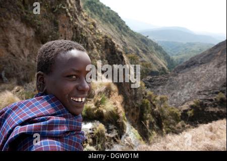 Ethnology, portrait, smiling Maasai boy, gorge at the Olmoti Crater, near Nainokanoka, Ngorongoro Conservation Area, - Stock Photo