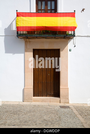 House decorated with Spanish flag on National day Ronda, Spain - Stock Photo