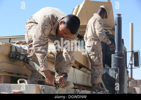 U.S. Marine Corps Lance Cpls. Maurice Johnson and Javeline Montgomery, both with Headquarters and Support Company, - Stock Photo