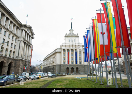 Nezavisimost Square in the town centre with the National Assembly building and international flags, Sofia, Bulgaria, - Stock Photo