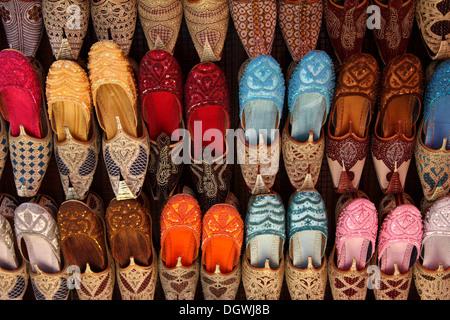 Display of colorful Indian shoes on sale in the Bur Dubai Souk, Dubai,  United Arab Emirates - Stock Photo