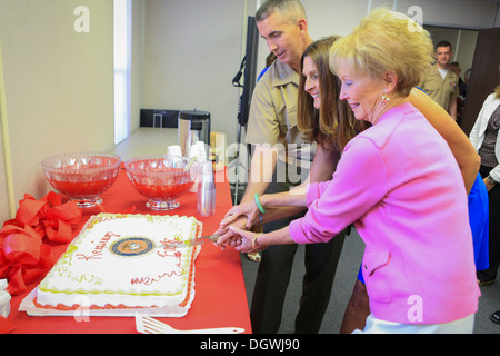 First Lady of the Marine Corps Mrs. Bonnie Amos cuts a cake during the opening of the new Marine Corps Community - Stock Photo
