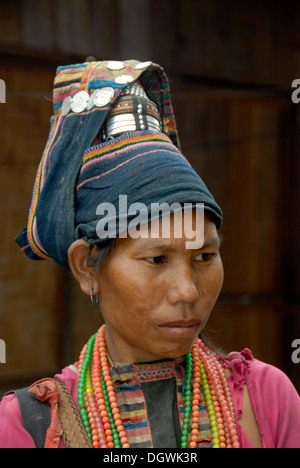 Poverty, portrait, woman of the Akha Pala ethnic group, turban, traditional headgear, Pak Nam Noi, Muang Khoua district - Stock Photo