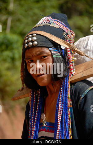 Poverty, ethnology, portrait, woman of the Akha Djepia ethnic group, traditional colorful clothes with indigo, headgear, - Stock Photo