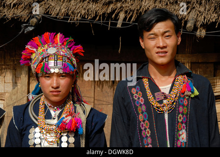 Portrait, woman and man of the Akha Loma ethnic group, colorful traditional clothing, traditional costume, Ban Noy - Stock Photo