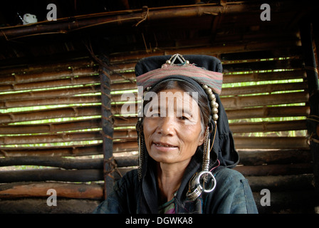 Poverty, ethnology, portrait, older woman of the Akha Nuqui ethnic group, traditional traditional costume, traditional - Stock Photo