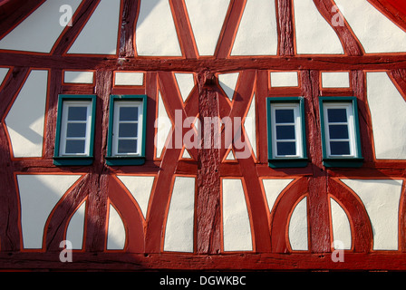 Detail, old renovated half-timbered house, red beams, narrow windows, Muehlheim am Main, Hesse - Stock Photo