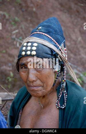 Poverty, portrait, woman of the Akha Djepia ethnic group, traditional clothes, hat with silver buttons, Namo district - Stock Photo