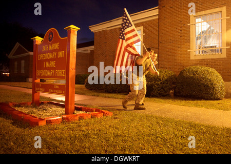 The Marines and Sailors of the 24th Marine Expeditionary Unit ran in honor of the 241 Marines, Sailors and soldiers - Stock Photo